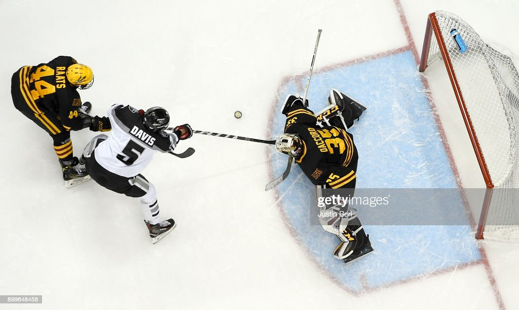 Joey Daccord #35 of the Arizona State Sun Devils makes a save on a shot by Tommy Davis #5 of the Providence Friars during the game at PPG PAINTS Arena on December 29, 2017 in Pittsburgh, Pennsylvania.