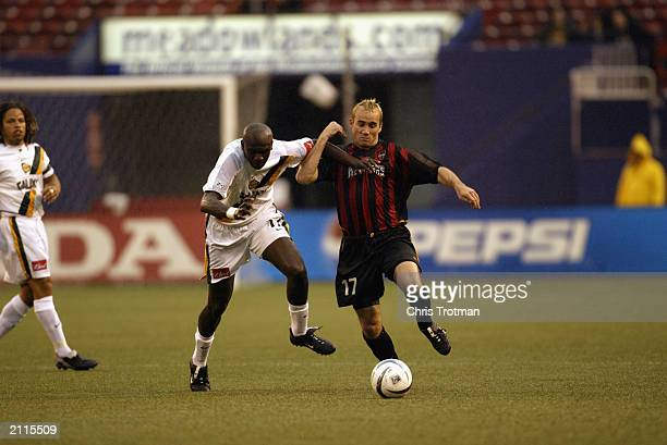 Joey DiGiamarino of the Metrostars battles with Ezra Hendrickson of the Los Angeles Galaxy at Giants Stadium on June 21, 2003 in East Rutherford, New...