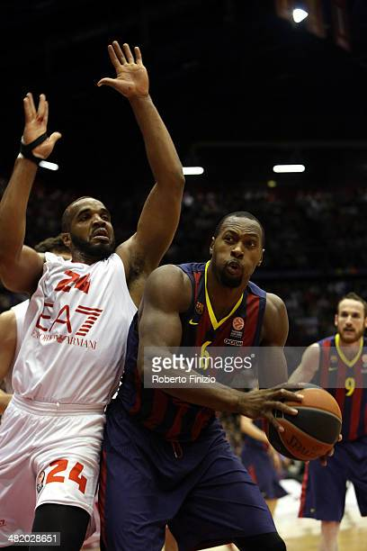 Joey Dorsey, #6 of FC Barcelona competes with Samardo Samuels, #24 of EA7 Emporio Armani Milan during the 2013-2014 Turkish Airlines Euroleague Top...