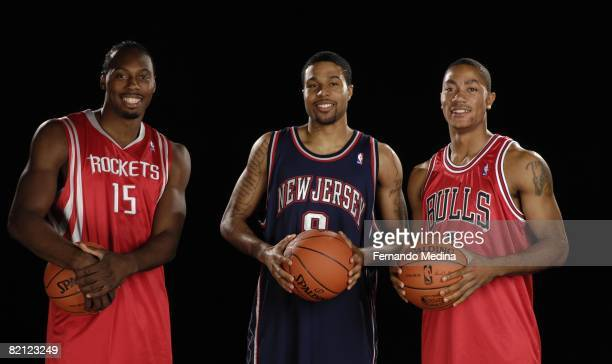 Joey Dorsey of the Houston Rockets Chris DouglasRoberts of the New Jersey Nets and Derrick Rose of the Chicago Bulls pose for a portrait during the...