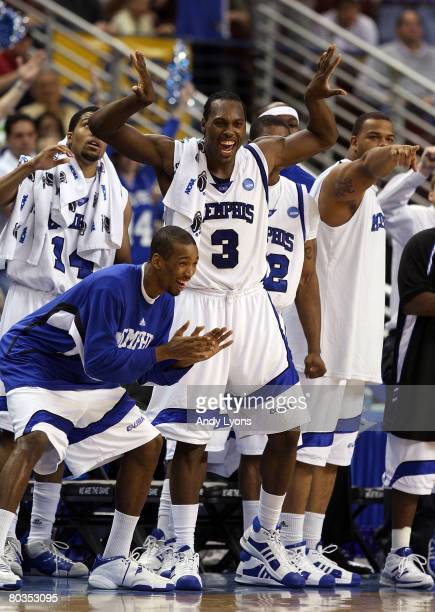 Joey Dorsey of the Memphis Tigers and teammates react from the bench in the second half against the Mississippi State Bulldogs during the second...