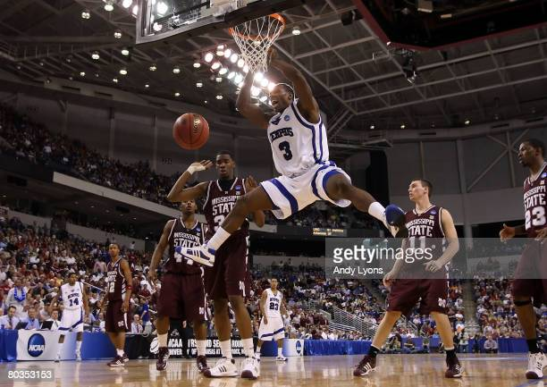Joey Dorsey of the Memphis Tigers dunks the ball as Jarvis Varnado of the Mississippi State Bulldogs looks on during the second round of the South...