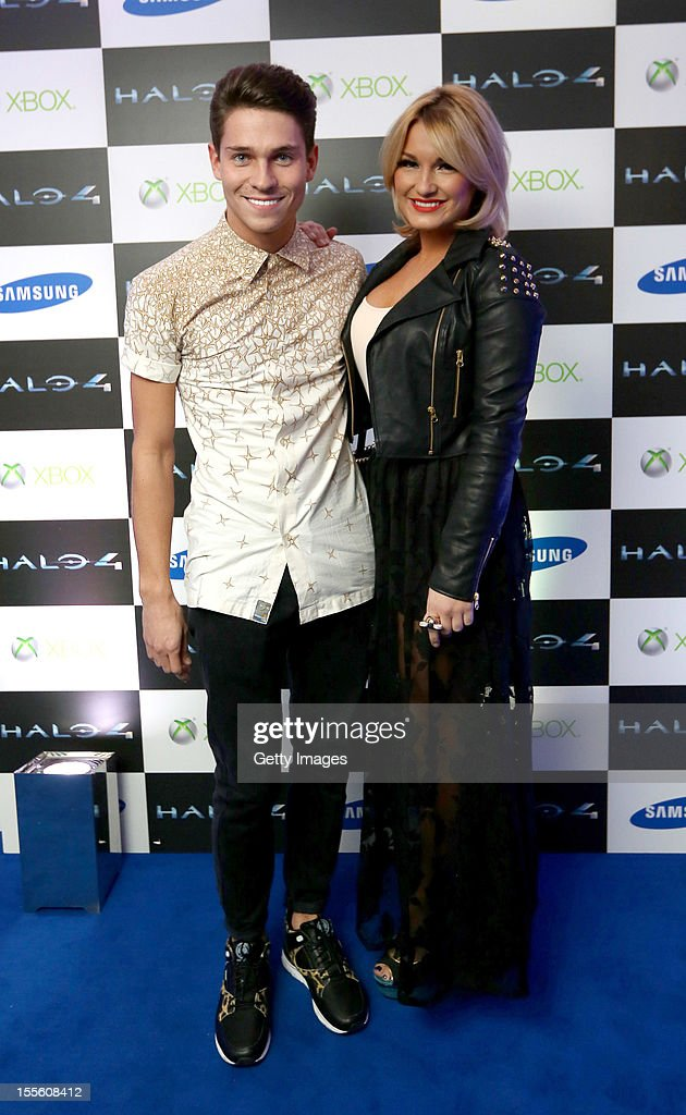 Joey Essex and Sam Faiers attend the launch of Halo 4 on Xbox 360 at Tower Bridge on November 05, 2012 in London, England. The 'Halo 4' Glyph symbol is one of the largest and brightest man-made structures to ever fly over a capital city and measures 50 feet in diameter and weighs over three tons.