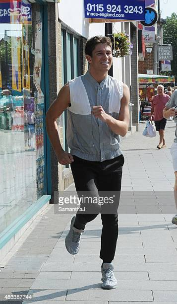 Joey Essex is seen running to his shop Fusey where he changes into one of his new T shirts and poses with fans outside his shop on August 8 2015 in...