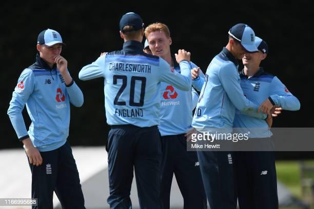 Joey Evison of England U19s celebrates with team mates after dismissing Pragnesh Kanpillewar of IndiaU19s during an Under 19 TriSeries match between...