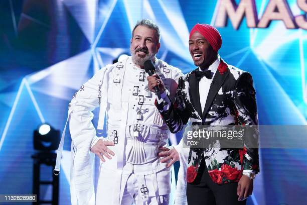 Joey Fatone and host Nick Cannon in the Semi Finals Double Unmasking episode of THE MASKED SINGER airing Wednesday Feb 20 on FOX