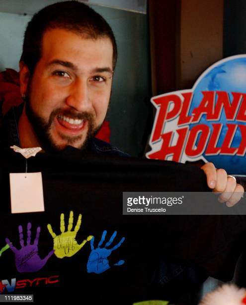 Joey Fatone signs Tshirts for NSYNC's charity 'Challenge for the Children' at Planet Hollywood Las Vegas