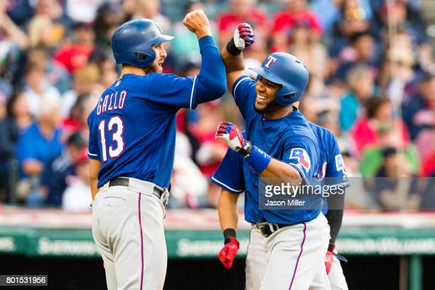Joey Gallo and ShinSoo Choo celebrate with Elvis Andrus of the Texas Rangers after all scored on a home run by Andrew during the second inning...