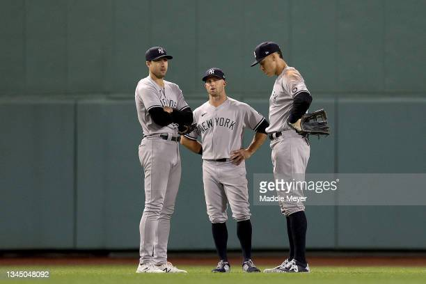 Joey Gallo, Brett Gardner and Aaron Judge of the New York Yankees stand in the outfield during a pitching change against the Boston Red Sox during...