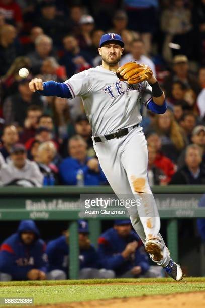 Joey Gallo of the Teaxs Rangers throws to first base in the sixth inning of a game against the Boston Red Sox at Fenway Park on May 24 2017 in Boston...