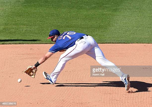 Joey Gallo of the Texas Rangers attempts to make a play on a ground ball against the Kansas City Royals during the eighth inning on March 4 2015 in...