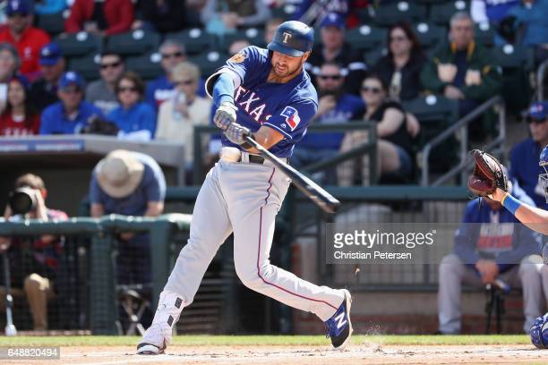 Joey Gallo of the Texas Rangers bats against the Kansas City Royals during the spring training game at Surprise Stadium on February 26 2017 in...