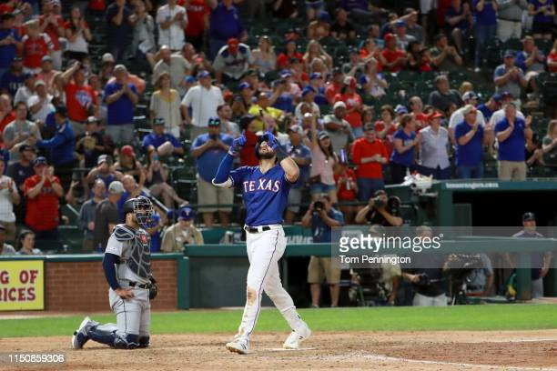 Joey Gallo of the Texas Rangers celebrates after hitting a tworun home run against the Seattle Mariners in the bottom of the eighth inning at Globe...