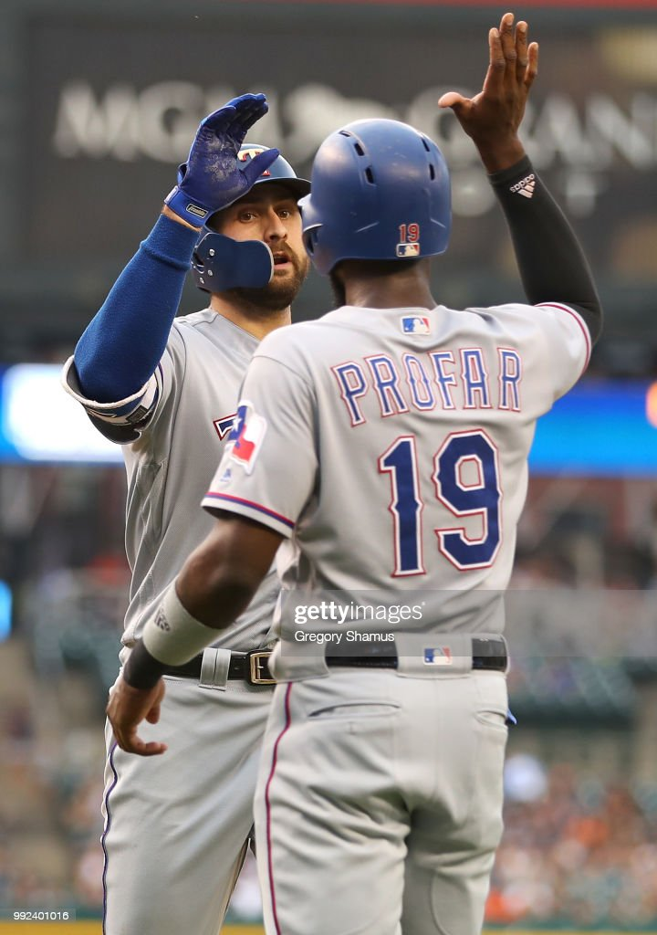 Joey Gallo #13 of the Texas Rangers celebrates his two run second inning home run with Jurickson Profar #19 while playing the Detroit Tigers at Comerica Park on July 5, 2018 in Detroit, Michigan.