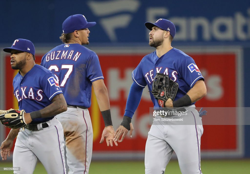 Joey Gallo #13 of the Texas Rangers celebrates their victory with Ronald Guzman #67 during MLB game action against the Toronto Blue Jays at Rogers Centre on April 27, 2018 in Toronto, Canada.
