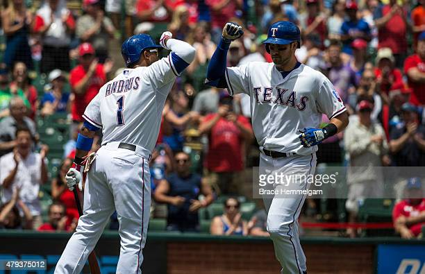 Joey Gallo of the Texas Rangers celebrates with Elvis Andrus after hitting a home run against the Minnesota Twins on June 14 2015 at Globe Life Park...