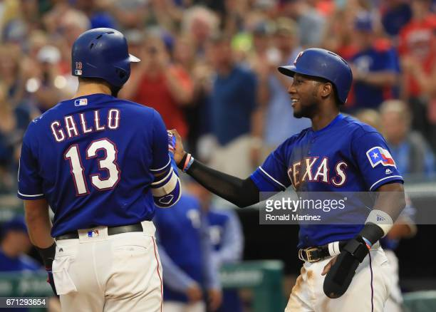 Joey Gallo of the Texas Rangers celebrates with Jurickson Profar after hitting a tworun home run against the Kansas City Royals in the second inning...