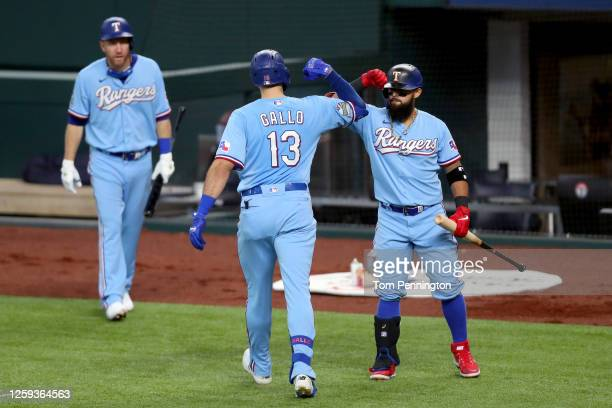 Joey Gallo of the Texas Rangers celebrates with Rougned Odor of the Texas Rangers after hitting a solo home run against the Colorado Rockies in the...