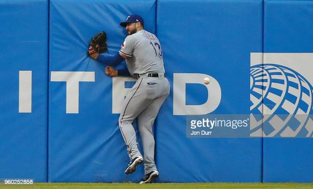 Joey Gallo of the Texas Rangers collides with the outfield wall while tracking the tworun RBI triple hit by Daniel Palka of the Chicago White Sox...