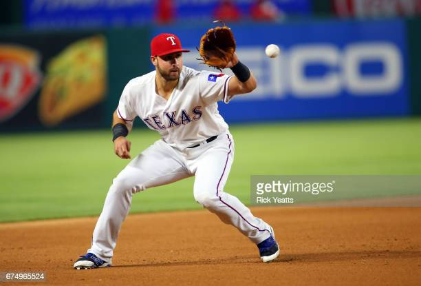 Joey Gallo of the Texas Rangers fields a infield hit against the Los Angeles Angels of Anaheim throwing out the runner on first base at Globe Life...