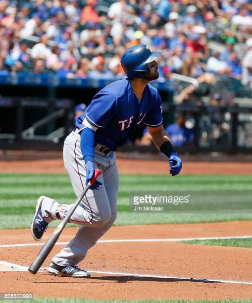 Joey Gallo of the Texas Rangers follows through on a first inning two run home run against the New York Mets at Citi Field on August 9 2017 in the...