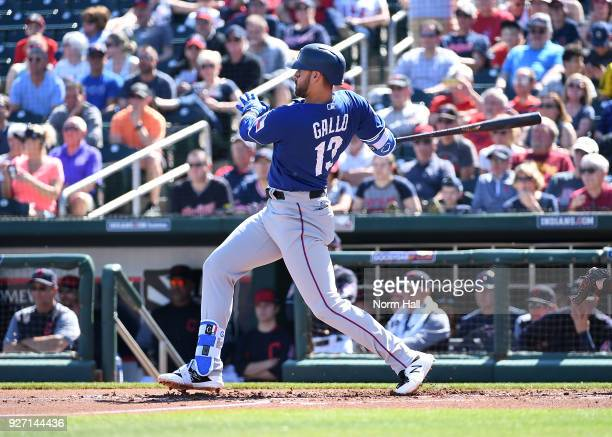 Joey Gallo of the Texas Rangers follows through on a swing during a spring training game against the Cleveland Indians at Goodyear Ballpark on March...