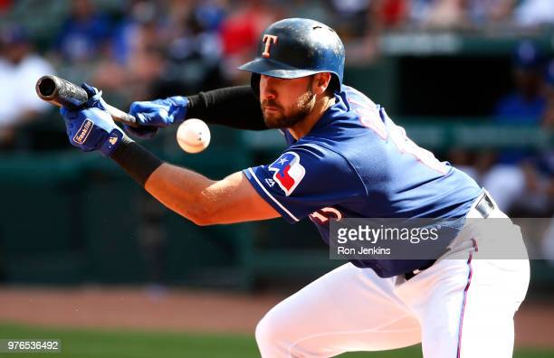 Joey Gallo of the Texas Rangers fouls off a bunt attempt against the Colorado Rockies during the eighth inning at Globe Life Park in Arlington on...