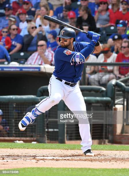 Joey Gallo of the Texas Rangers gets ready in the batters box against the Seattle Mariners during a spring training game at Surprise Stadium on March...