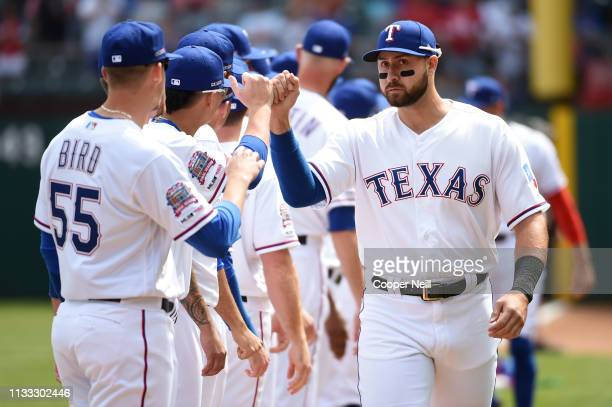 Joey Gallo of the Texas Rangers highfives teammates during player introductions before the game between the Chicago Cubs and the Texas Rangers at...