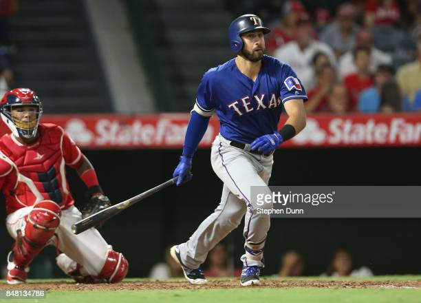 Joey Gallo of the Texas Rangers hits a double in the fifth inning against the Los Angeles Angels of Anaheim on September 16 2017 at Angel Stadium of...
