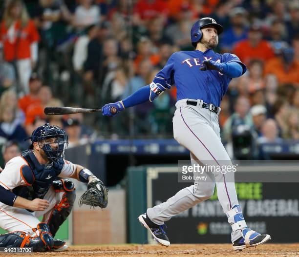 Joey Gallo of the Texas Rangers hits a home run in the eighth inning as Brian McCann of the Houston Astros looks on at Minute Maid Park on April 14...