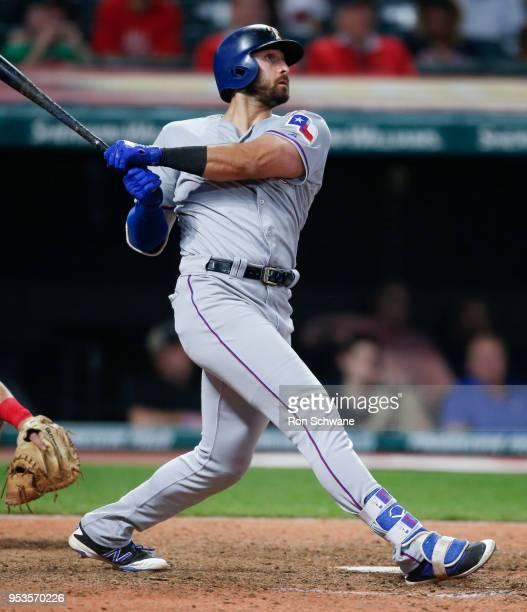 Joey Gallo of the Texas Rangers hits a solo home run off Nick Goody of the Cleveland Indians during the 12th inning at Progressive Field on May 1...