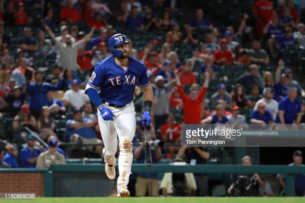 Joey Gallo of the Texas Rangers hits a tworun home run against the Seattle Mariners in the bottom of the eighth inning at Globe Life Park in...