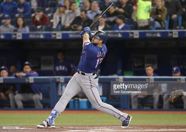 Joey Gallo of the Texas Rangers hits a tworun home run in the first inning during MLB game action against the Toronto Blue Jays at Rogers Centre on...