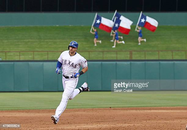 Joey Gallo of the Texas Rangers hits a tworun homer in the third inning during a game against the Chicago White Sox at Globe Life Park in Arlington...