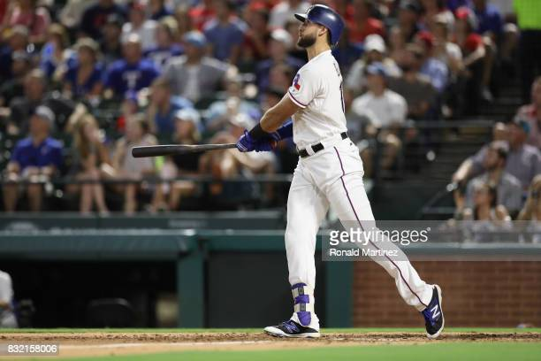 Joey Gallo of the Texas Rangers hits a tworun homerun against the Detroit Tigers in the fourth inning at Globe Life Park in Arlington on August 15...