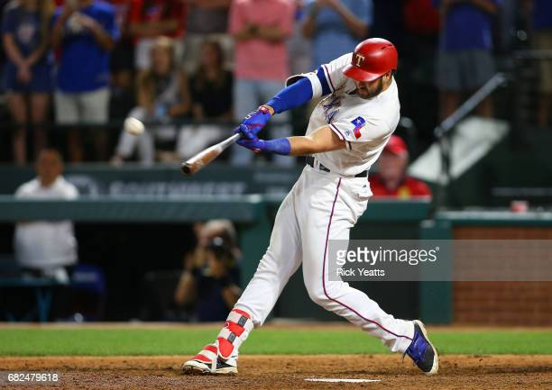Joey Gallo of the Texas Rangers hits a walk off home run in the ninth inning against the Oakland Athletics at Globe Life Park in Arlington on May 12...