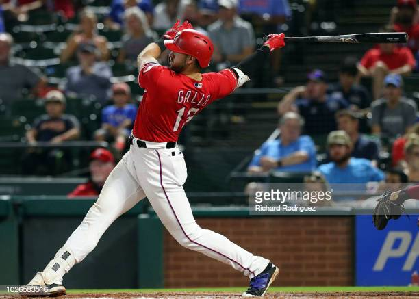 Joey Gallo of the Texas Rangers hits for an RBI double in the seventh inning against the Los Angeles Angels at Globe Life Park in Arlington on...
