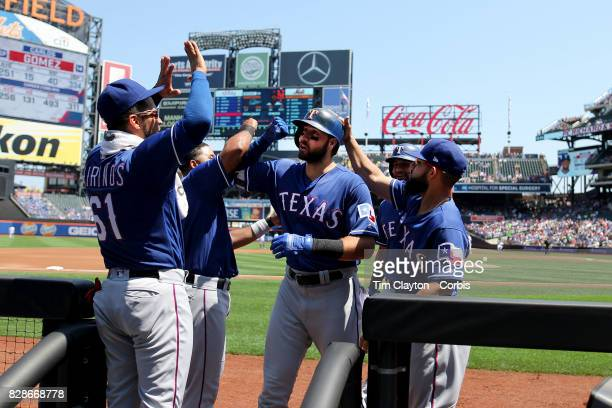 Joey Gallo of the Texas Rangers is congratulated by team mates as he returns to the dugout after hitting a two run home run in the first inning...