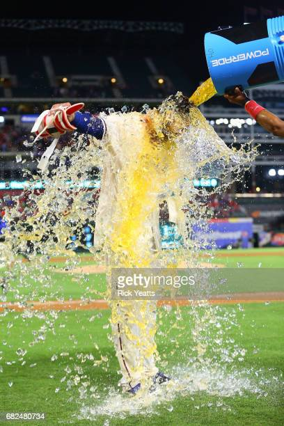 Joey Gallo of the Texas Rangers is doused with a cooler by teammate Elvis Andrus after hitting a walk off home run in the ninth inning against the...