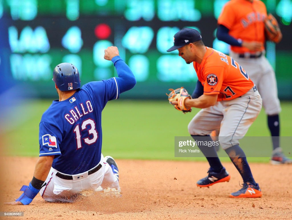Joey Gallo #13 of the Texas Rangers is tagged out on second base against Jose Altuve #27 of the Houston Astros at Globe Life Park in Arlington on April 1, 2018 in Arlington, Texas.