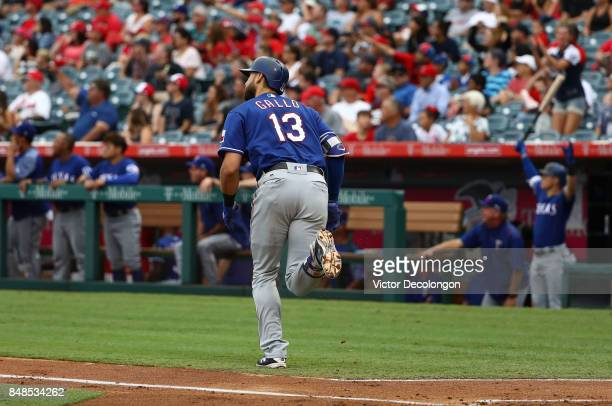 Joey Gallo of the Texas Rangers jogs to first base on his solo homerun during the second inning of the MLB game against the Los Angeles Angels of...