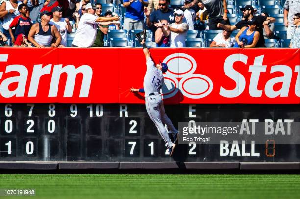 Joey Gallo of the Texas Rangers makes a catch over the wall during the game against the New York Yankees at Yankee Stadium on Sunday August 12 2018...