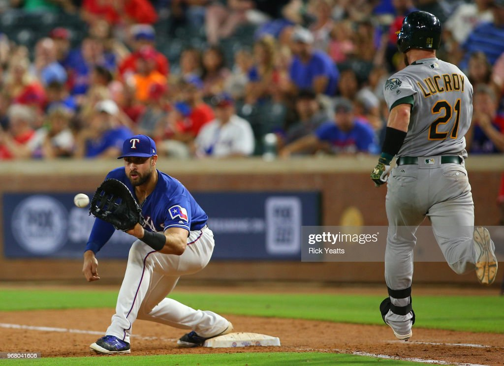 Joey Gallo #13 of the Texas Rangers makes the catch on first base in the seventh inning for the out on Jonathan Lucroy #21 of the Oakland Athletics at Globe Life Park in Arlington on June 5, 2018 in Arlington, Texas.