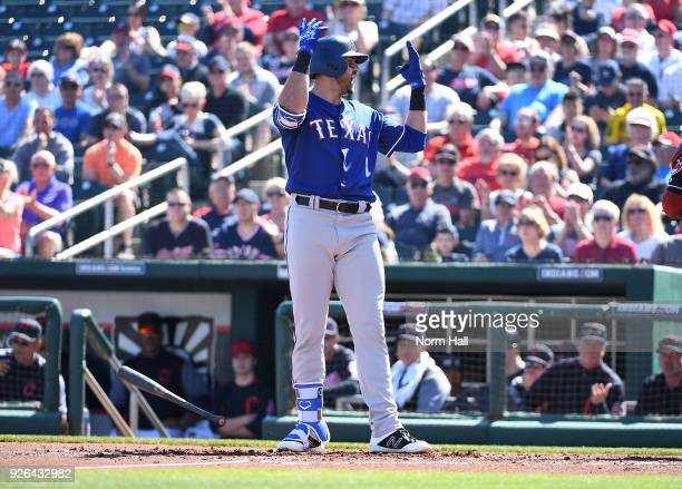 Joey Gallo of the Texas Rangers reacts after a third strike call during the first inning of a spring training game against the Cleveland Indians at...