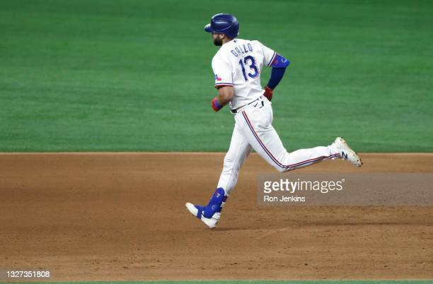 Joey Gallo of the Texas Rangers rounds the bases after hitting a home run against the Detroit Tigers during the ninth inning at Globe Life Field on...