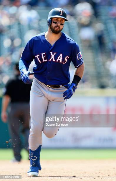 Joey Gallo of the Texas Rangers rounds the bases after hitting a solo home run against the Detroit Tigers during the second inning at Comerica Park...