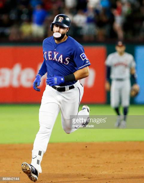 Joey Gallo of the Texas Rangers rounds the bases after hitting a solo home run during the second inning of a baseball game against the Houston Astros...