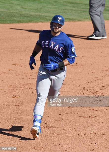 Joey Gallo of the Texas Rangers rounds the bases after hitting a solo home run during the sixth inning of a spring training game against the...