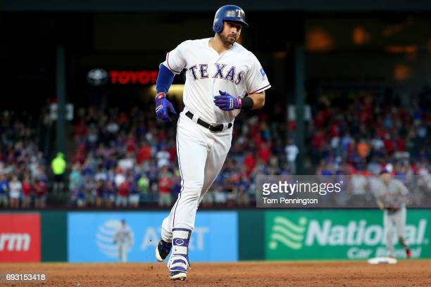 Joey Gallo of the Texas Rangers rounds the bases after hitting a two run homerun against the New York Mets in the bottom of the third inning at Globe...